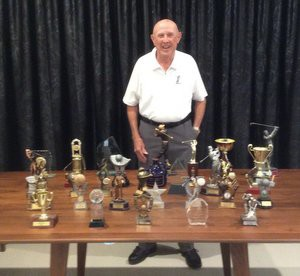 John with his collection of trophies