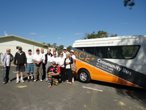 The team of WABGA golfers with the Ace+ Community Bus