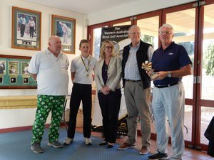Brad Carver with caddie Josiah Gilbert receiving their trophy from Dave Martin, Debra Barnes and John White